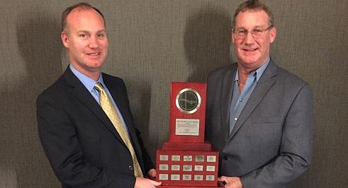 photo of jamie and rob mackinnon with the archie watt award
