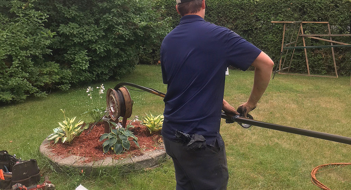 photo of well technician installing water pump in well