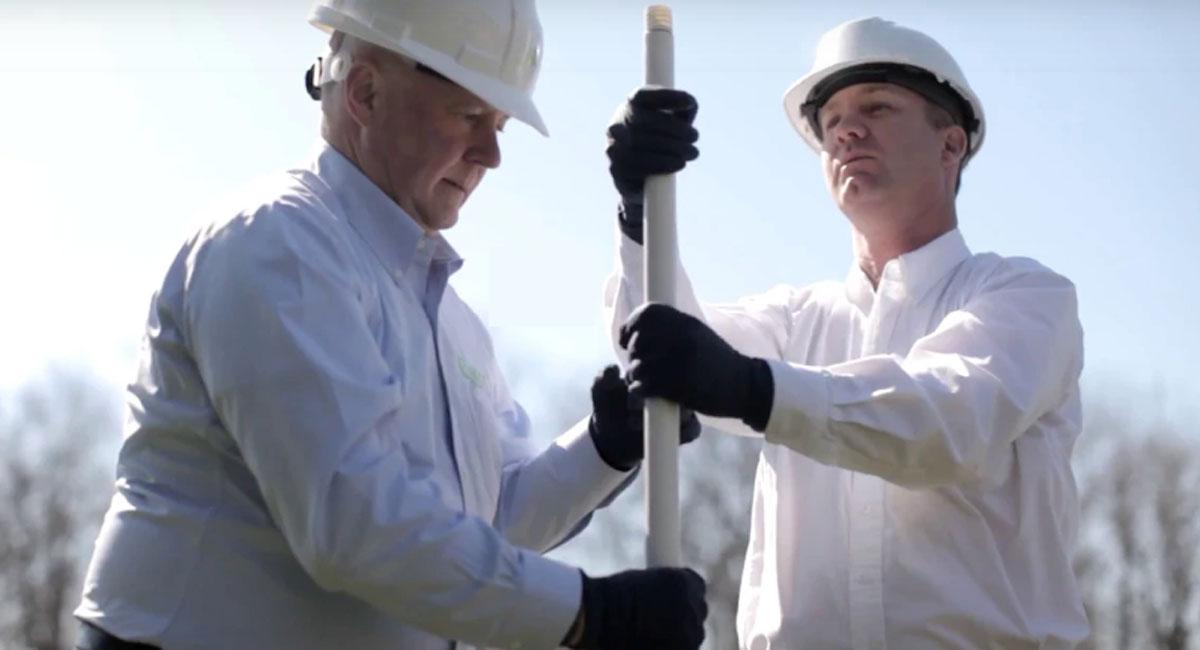 photo of jamie mackinnon and david innes installing airwell unit